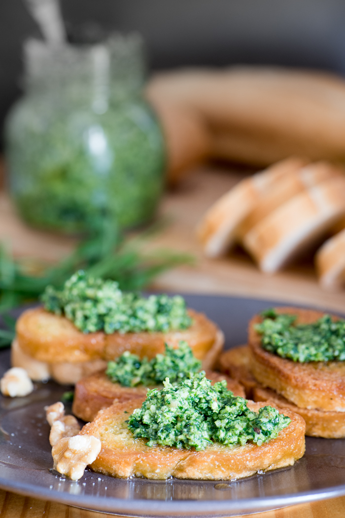 Pesto made with fresh arugula and walnuts makes an easy appetizer. Spread on crostini, put a little on grilled chicken or steak, toss with pasta. Eye opener! | The Recipe Wench
