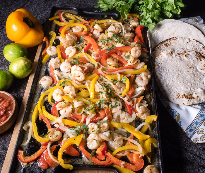 Shrimp fajitas are a brilliant and easy meal that can be cooked in the oven and served family style! | The Recipe Wench