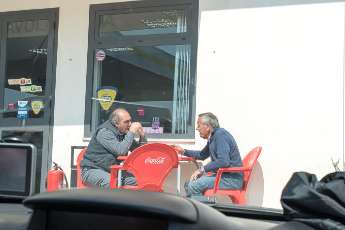 Two gentlemen outside an Autogrill on our road trip to Sicily