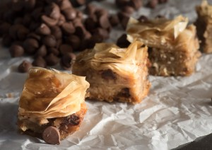 Chocolate Chip Baklava with layers of delicate, flaky (store bought!) phyllo dough. Drizzled with a brown sugar vanilla glaze | The Recipe Wench