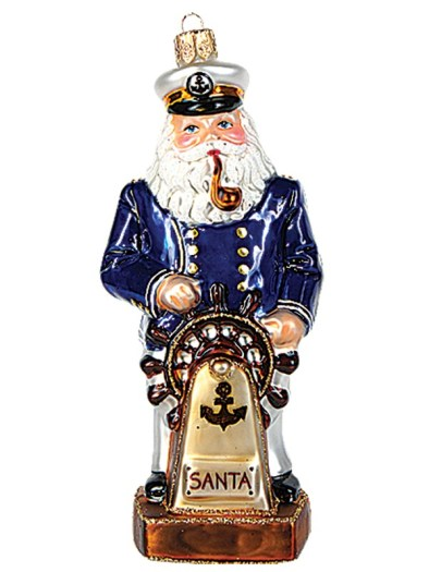 An ornament with Santa in a captain's outfit behind the wheel of a ship