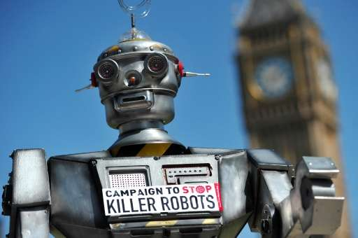 Robot with sign that says 'Campaign to Stop Killer Robots'