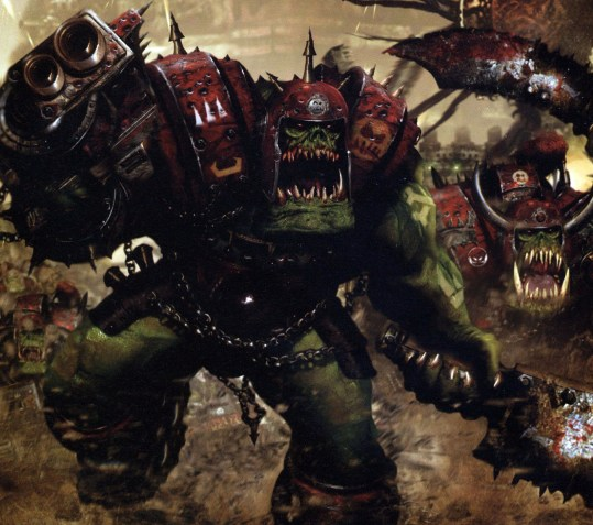 An Ork Nob charges furiously toward the viewer, wearing red armor