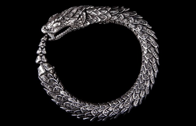 A  metal bracelet of a snake eating it's tail