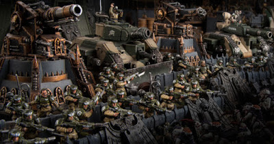 WH40k miniatures and tanks arrayed in battle formation awaiting attack
