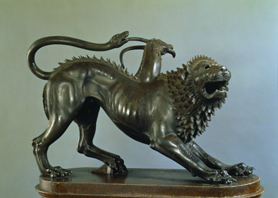 Bronze statutues of a chimera with a snake for a tail, a lion head, spines down the back, and an antelope head
