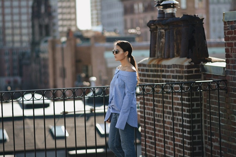 Boston Blogger Walking on Newbury Street Boston Wearing Striped Blue Shirt Ray-Ban Round Frames Sam Edelman Paris Mules in Red