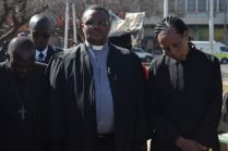 From left to right, Canon Daliwonga, P Hinana and BP Vinjwa (Behind them) Apiwe Mbutuma stood as one as they prayed for men in Komani, South Africa and in the world to respect and protect women and children