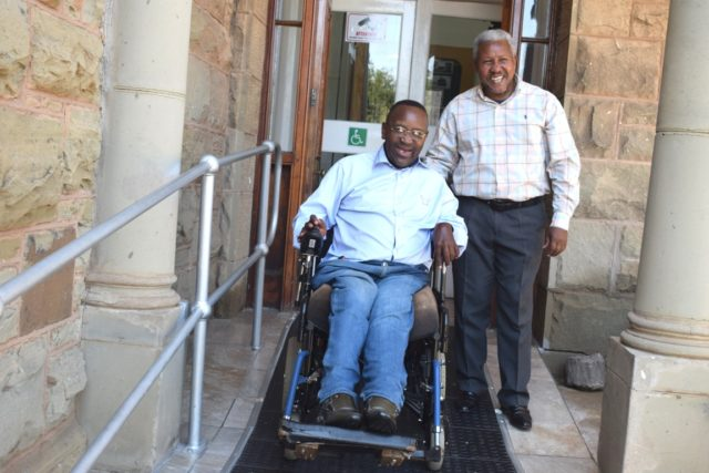 PASSED THE TEST: Enoch Mgijima Local Municipality disability council convener Thoza Mzilikazi tests the wheelchair ramp at the Queenstown and Frontier Museum with museum head Thobile Mdlela Picture: ZINTLE BOBELO