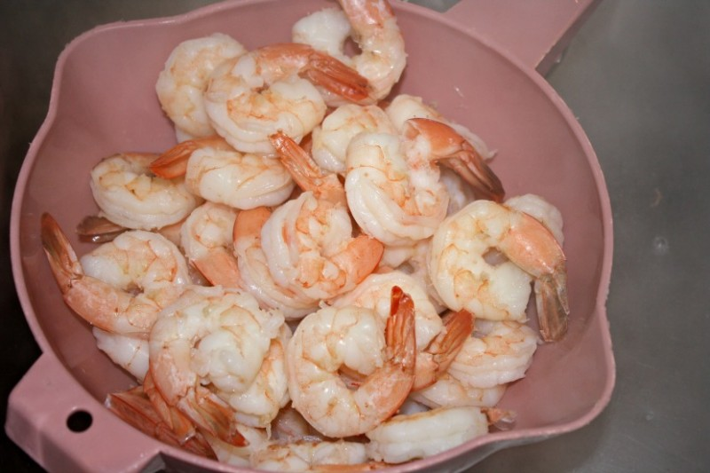 resized edited cooked shrimp with tails colander