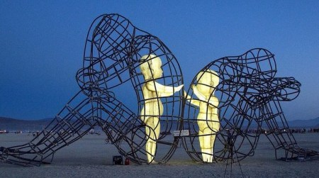 Inner Child Burning Man Sculpture. Children trapped within adult bodies.