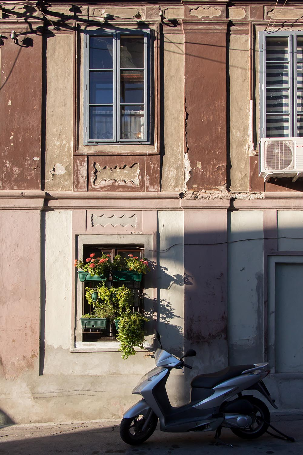 Old building facade and motorbike