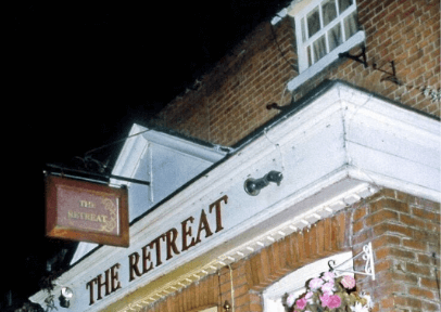 The Retreat pub sign in the early 2000s