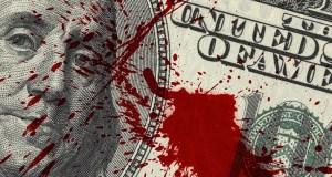 Dollar bill splashed with blood