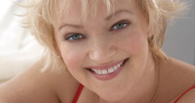 Blonde woman smiling to camera