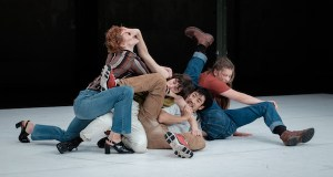 Four people are tangled on the floor