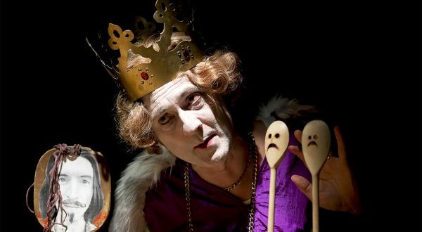 Man in crown with wooden spoon puppets