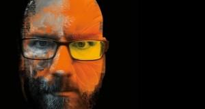 Bald man with beard looking angry