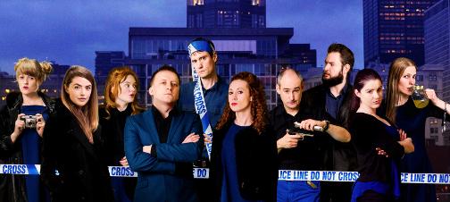 10 people standing behind scene of crime tape