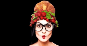 woman with croissant and strawberries on her head