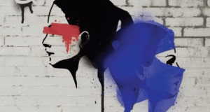 two womens heads spray painted on a wall