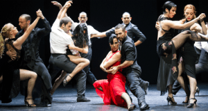 group of male and female dancers in hold dancing tango