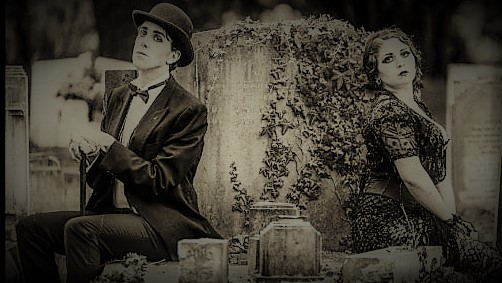 Man and woman sitting on grave