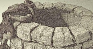 blavk and white image of a stone well