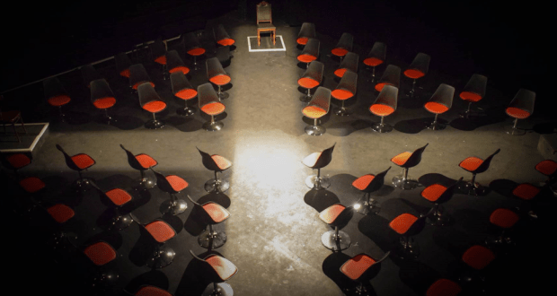 multiple swivel chairs in a black room