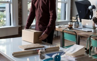 A man it's packing a box