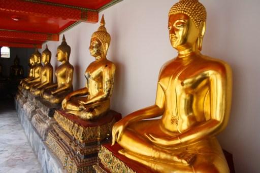 Golden buddha statues in Wat Po, bangkok, thailand