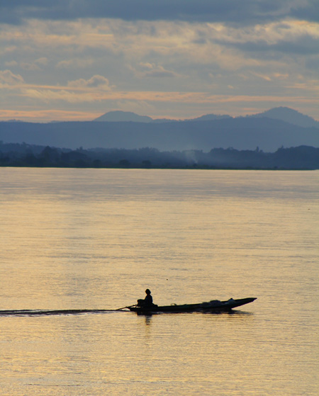 A boat on the Mekong River at Sunset in Vientiane, Laos