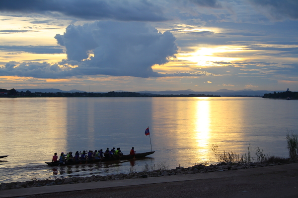 rowers at sunset on the Mekong River at Vientiane, laos