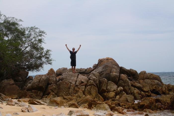 Scrambling over rocks on Koh Phangan, Thailand