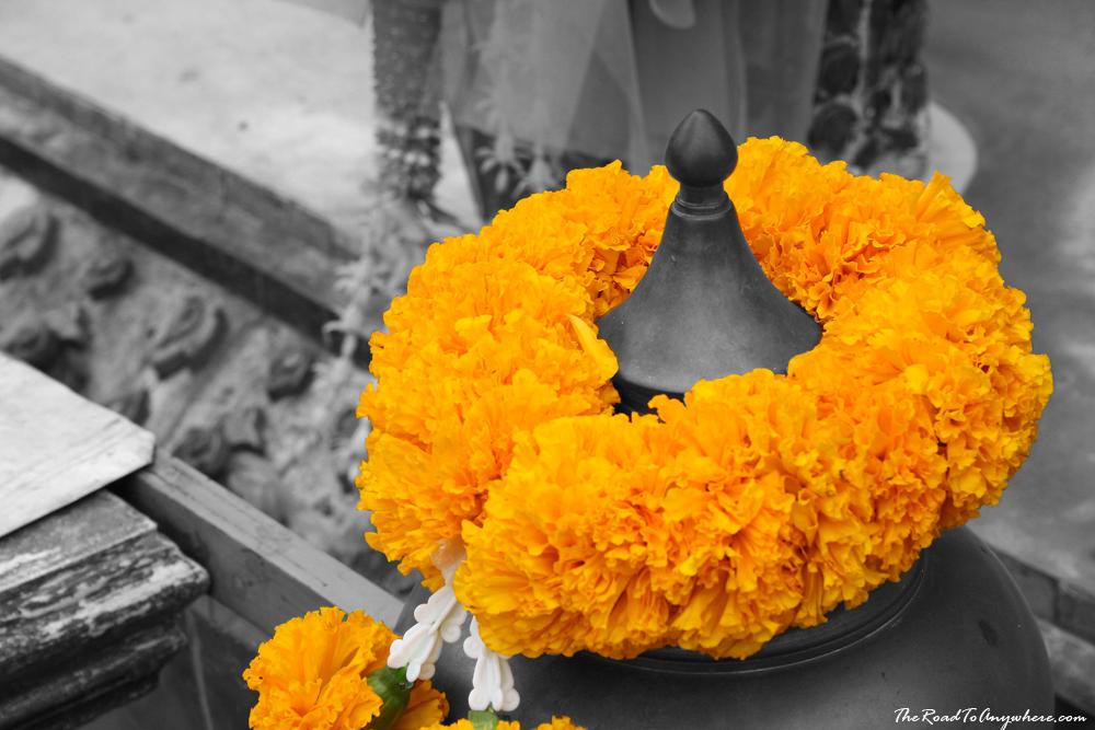 A Buddhist flower offering at Wat Arun in Bangkok, Thailand