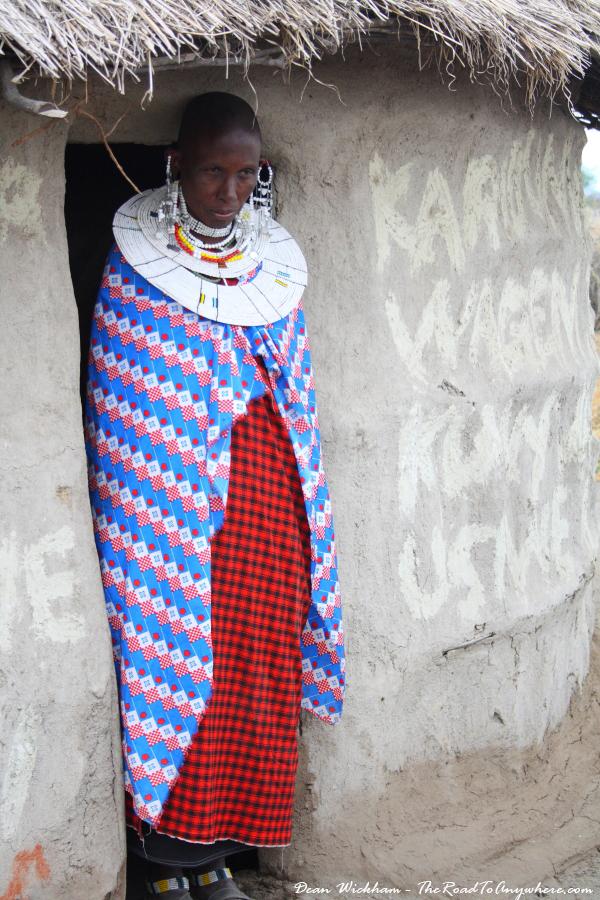 A Masai woman standing in her doorway in a Masai Village in Tanzania