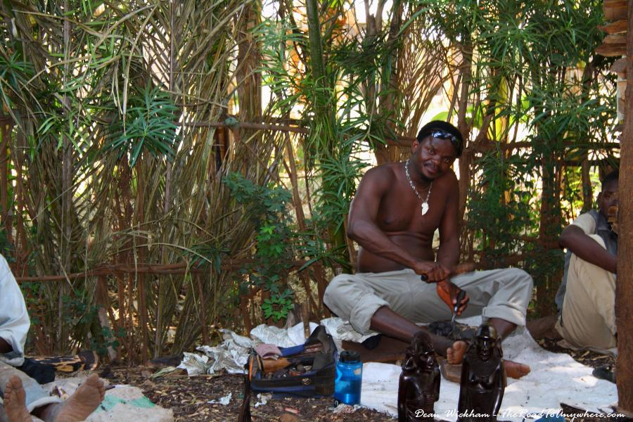A wood carver at work in Mto wa Mbu, Tanzania