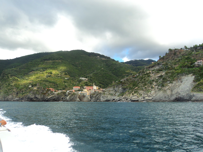 Passing Vernazza on the ferry on the way to Riomaggiore in Cinque Terre, Italy
