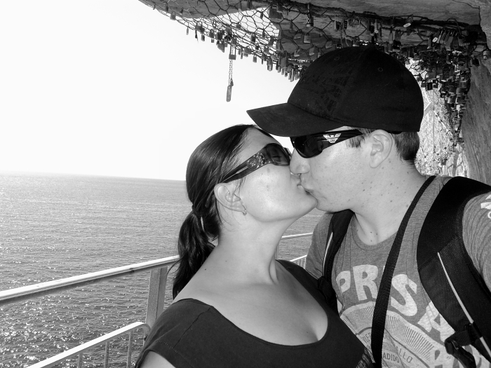 Honeymoon kiss on Via Dell'Amore in Cinque Terre, Italy