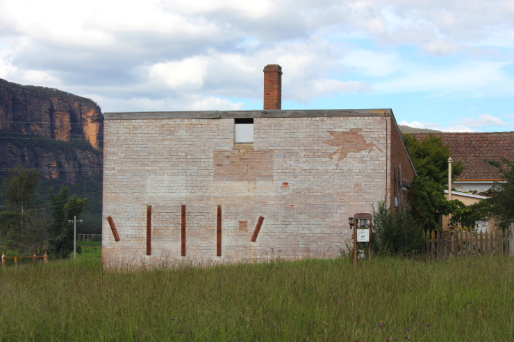 Old abandoned petrol bowser in Glen Davis, Australia