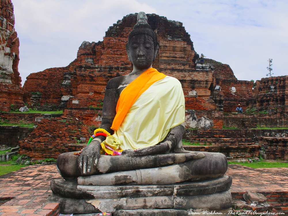 A Buddha Statue at the ruined temple of Wat Mahathat in Ayutthaya, Thailand