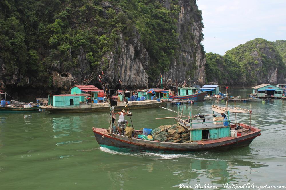 A boat in the floating fishing village in Han La Bay, Vietnam