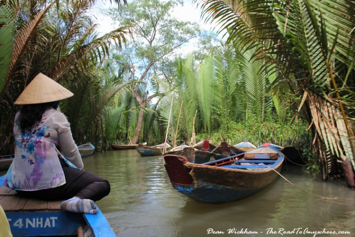 Paddling through a natural canal in the Mekong Delta, Vietnam