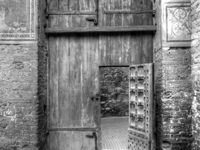 Old wooden door in Palazzo Comunale in San Gimignano, Italy