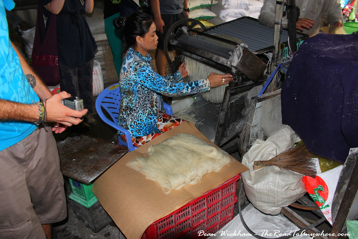Collecting noodles at a rice noodle factory in the Mekong Delta, Vietnam