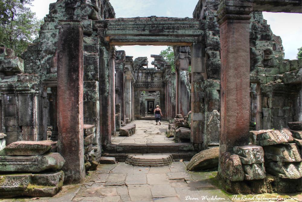 Exploring an ancient hallway at Preah Khan in Angkor, Cambodia