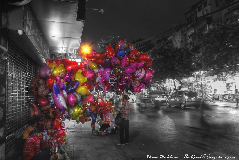 Ladies selling balloons in Hanoi, Vietnam
