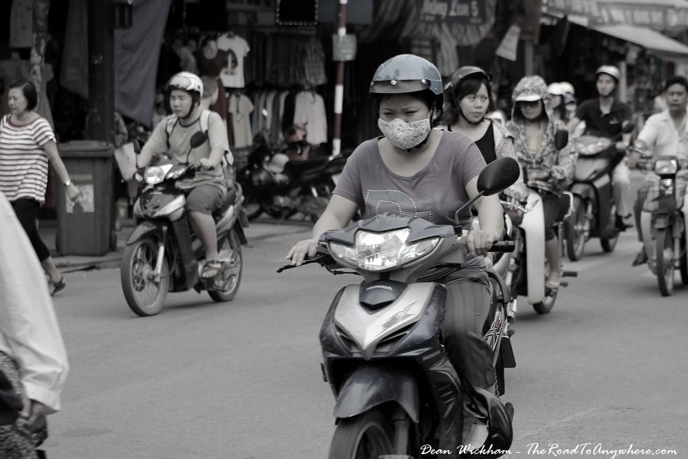Lady on a motorbike in Hanoi, Vietnam