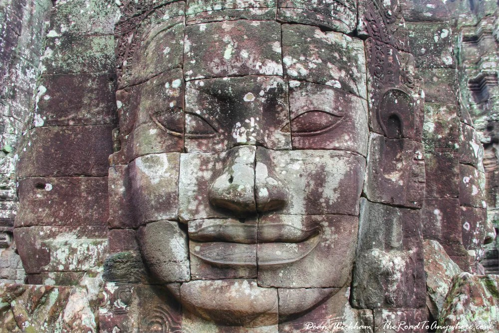 An ancient stone face at the temple of Bayon in Angkor Thom, Cambodia