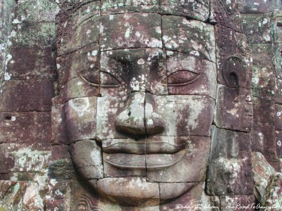 Ancient stone face at Bayon in Angkor Thom, Cambodia